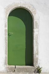 Metallic green door in Crete. Greece