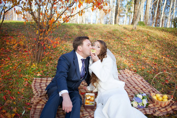 Fun portrait of happy wedding couple in autumn forest