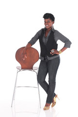 African business woman posing next to chair