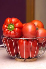 Tomatoes with paprika in basket on table
