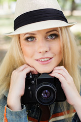 Nice blonde girl photographer with camera