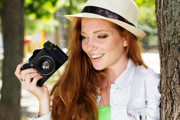 Nice girl photographer at work