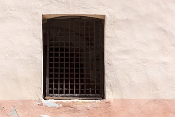 Window with lattice in old wall.