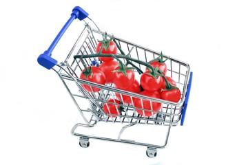 Ripe cherry tomato in shopping cart