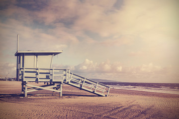 Vintage retro picture of wooden lifeguard tower, Beach in Califo