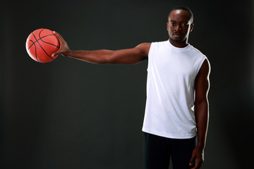 Portrait of African American man holding basketball ball