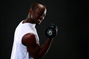 handsome african sports man over black background