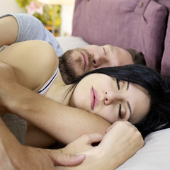 Happy couple sleeping hugged