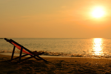 Silhouette of beach chair and sunset