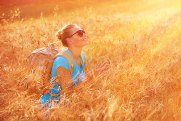Enjoying wheat field on sunset