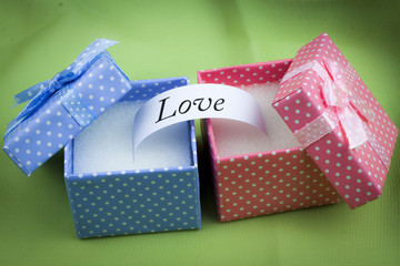 LOVE message on blue and pink present boxes