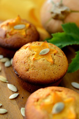 Sweet pumpkin muffins in metal molds .