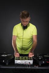 DJ posing with turntable