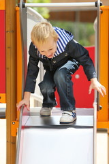 Young boy playing in a park