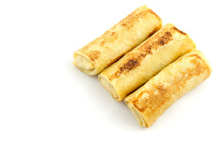 rolled pancakes isolated on white with place for text