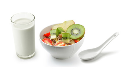 fresh milk in the glass and muesli breakfast placed on white bac