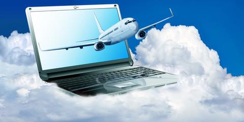 Passagierflugzeug mit Laptop über den Wolken