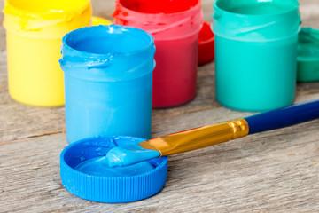 Blue watercolor paints with paintbrush