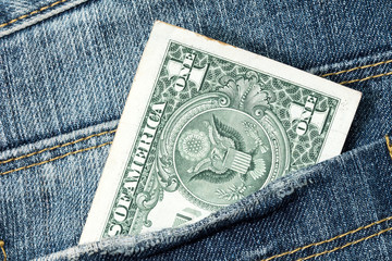 One dollar note in the jeans pocket