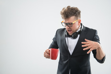 Hipster in bowtie is getting angry about the cup