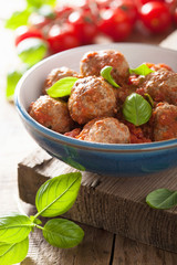 meatballs with tomato sauce in blue bowl