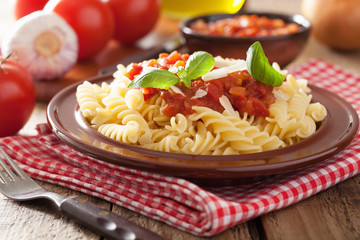 italian pasta fusilli with tomato sauce and basil