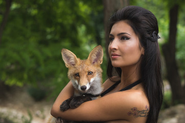 Attractive woman and fox