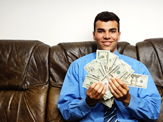 Young man in blue shirt shows you money