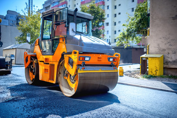 Heavy tandem Vibratory roller compactor working on asphalt
