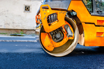Heavy Tandem Vibration roller compactor at asphalt pavement work