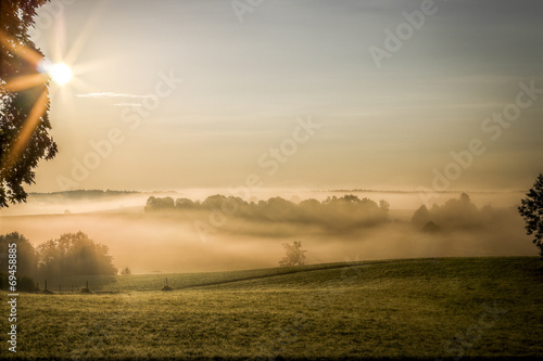 canvas print picture nebliger Sonnenaufgang