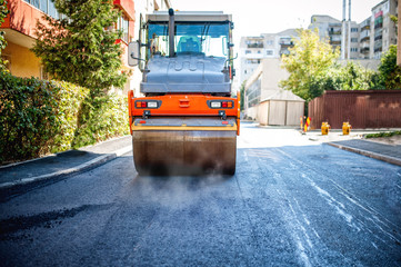 road repairing in urban modern city with heavy vibration roller