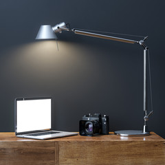 Laptop With Photo Camera Under The Lamp In Interior Room