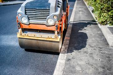 Heavy Vibration roller compactor at asphalt pavement works