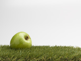 apple on grass world enviromental concept on white