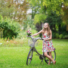 Happy girl with bicycle