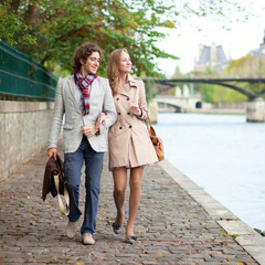 Romantic couple in Paris at the embankment