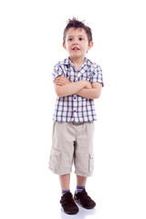 Portrait of  beautiful little boy standing with arms crossed on