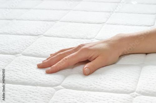 Leinwanddruck Bild Choosing mattress and bed.