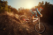 Downhill mountain bike. Man cyclist riding bicycle - 69463689