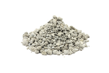 a handful of cement rubble on a white background