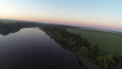 Beautiful  sunrise  with lake and fields .Aerial  landscape