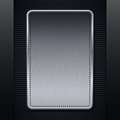 Brushed metallic plaque on carbon background