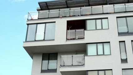 modern building - balcony - windows - blue sky