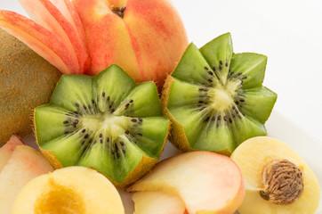kiwi and peaches isolated on white background