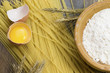 Raw spaghetti, wheat stalk, egg and flour