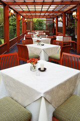close up wooden chairs and table in restaurant