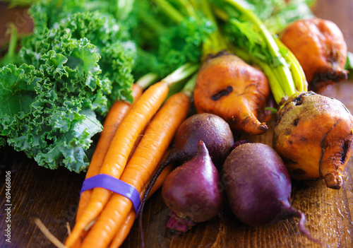 pile of veggies with carrots, beets and kale - 69466806