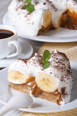 Piece of banana cake Banoffee on a white plate vertical