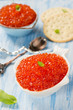Red caviar in fish-shape bowl